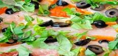 Рыба с помидорами и оливками